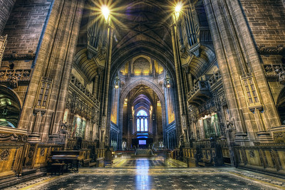 Screen in the Liverpool Cathedral  The screen is in the middle. There were preparing for some award show (or something like it) when I was there. So that why it was there. I went for a little darker and cooler look for this shot. I also did double tone-mapping here to get even bore details in this shot. For anyone who hasn't heard of double tone-mapping yet, it that when you process your photo in Photomatix, and you finish, you just hit tone-mapping again. On photos like this, where you have a lot of detail, this can create  very nice results.  HDR from three shots, taken with Canon 450D with Sigma 10-20mm lens, from a tripod.