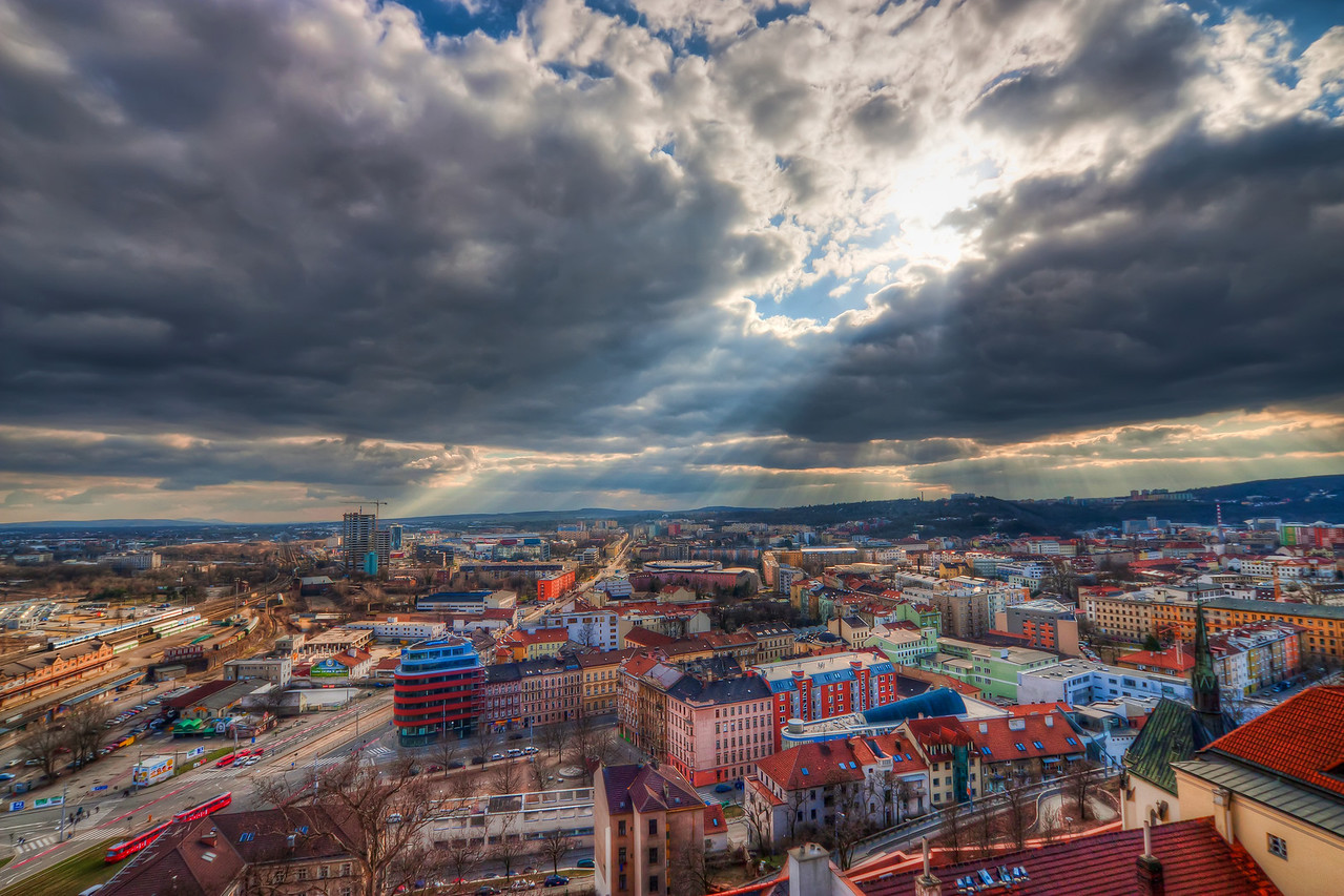 Broken clouds over Brno  I took this photo few months ago, while visiting Brno. I go there from time to time, as it's not far from Bratislava, and they cook great Czech food in the pubs there :). This photo was taken from the top of the St. Peter and Paul's Cathedral. I had quite a luck here, as I was alone there at that time :). It's a really small space, I had problems standing next to my tripod :)  HDR from three shots, taken with Canon 450D with Sigma 10-20mm lens, from a tripod.