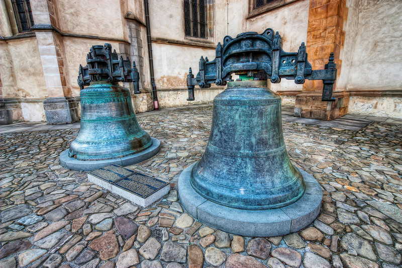 Bells in Bardejov  It's not often you can see church bell so up close, but in Bardejov, you can see two right in front of the church. They both have such a great detail on them, ideal for HDR :)  HDR from three shots, taken with Canon 450D with Sigma 10-20mm lens, from a tripod.