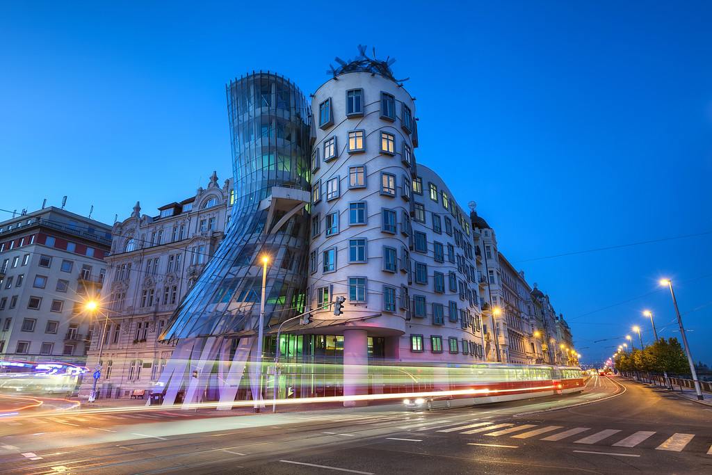 Dancing in the morning Let's continue with the Prague photos. I took many photos of this Dancing house during the last two years, but this is the first one I actually like. All it took was to wake up at 4am, so I can be there at 5am. Only thing I would want more would be few clouds, but also without them it looks quite good :)