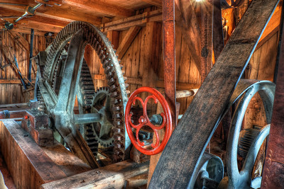 Red Wheel  Some time ago I uploaded a photo of the water mill in Jelka. This is one of the shots I took inside, the mechanism moving the whole mill. I of course took more shots, which I will add later on :)  HDR from three shots, taken with Canon 450D with Sigma 10-20mm lens, from a tripod.