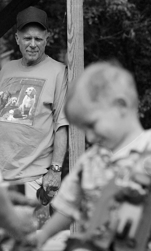 Luke's Grandfather looks on during his birthday.