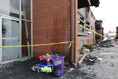 Items that survived the fire at 750 Maple Street await pickup.