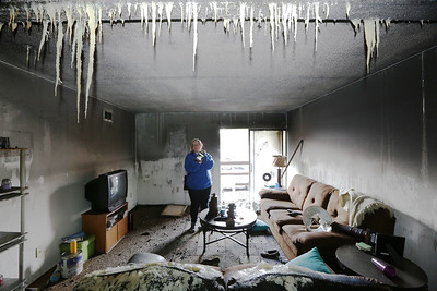 Casey Miller shows surprise that her Nook is still working after a fire destroyed her apartment at 750 Maple Street