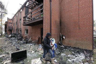Ceciia Wolff helps with clothes after her best friends apartment was destroyed in a fire at 750 Maple Street, Mansifield, Ohio.