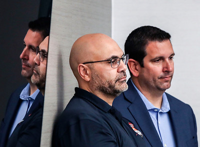Ali Farhang, center, Chairman of the Board for the Arizona Bowl, and Eric J. Rhodes, Vice President of Communications, listen during a press conference for Arkansas State at the AC Hilton Friday, Dec 28, 2018 in Tucson, Arizona.