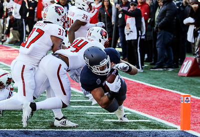 Nevada tight end Reagan Roberson (31) dives into the endzone for the game winning touchdown in overtime against Arkansas State during the Arizona Bowl at Arizona Stadium Satuday, Dec 29, 2018 in Tucson, Arizona.