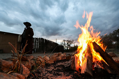 "A Reenactor only known as ""Jeb"" keeps warm near the fire at Old Tucson Thursday, Dec 27, 2018, in Tucson, Arizona. Jeb is one of the Cowboys who rides around and ""keeps the peace"" in the city."