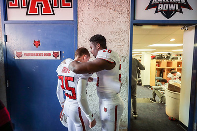 Arkansas State kicker Blake Grupe (25) gets some words of encouragement from safety Trent Ellis-Brewer (26) during halftime of the Arizona Bowl at Arizona Stadium Satuday, Dec 29, 2018 in Tucson, Arizona. Grupe had just missed a field goal in the final seconds of the half.