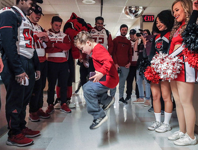 Mason Roberts, 6, of Sierra Vista, AZ, takes some time out from his leukemia treatment to dance for players and cheerleaders from the Arkanasas State Football team during their visit to Diamond Childrens Medical Center as part of their Arizona Bowl experience Thursday, Dec 27, 2018 in Tucson, Arizona.