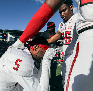 Arkansas State's Jefferie Gibson is consoled by teammates after his team looses the Arizona Bowl to Nevada 16-13 in overtime at Arizona Stadium Satuday, Dec 29, 2018 in Tucson, Arizona.