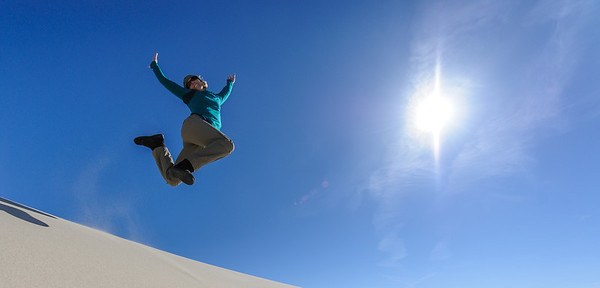 Susan leaping off a dune, Eureka Dunes, Death Valley National Park