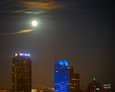 Almost one hour after it's rise, the SuperMoon shines over Pittsburgh's corporate highrises: BNY Mellon, Oxford Center (in blue) and the older Grant Building (with the green light)  Shot on 12/3/17 at 7:15p ©John Schiller Photography