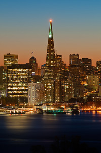 Transamerica Pyramid Tower with its tip lit in San Francisco Giants orange.