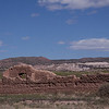 """Ruin of the old Church of Abiquiu with the cliffs of Georgia O'Keef's """"White Place"""" in the background."""