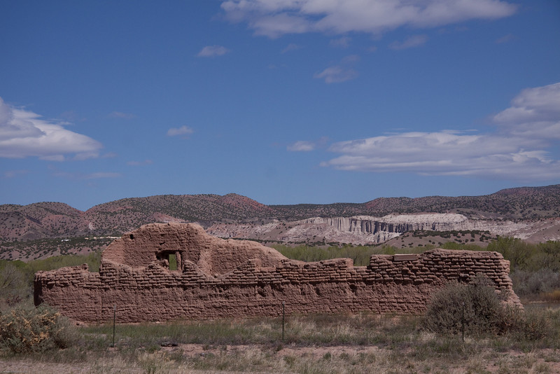 "Ruin of the old Church of Abiquiu with the cliffs of Georgia O'Keef's ""White Place"" in the background."