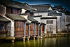 Houses in the ancient village of Wuzhen in China. They are built on pilings, in the middle of a lake.
