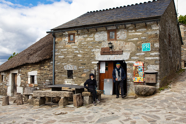 """O Cebreiro.<br /> <br /> Here is how Rick Steves describes it:<br /> <br /> """"Perched on a high ridge, the impossibly quaint hobbit hamlet of O Cebreiro welcomes visitors to Galicia — a hilly, damp, green region in northwest Spain that feels vaguely Irish. O Cebreiro is a time-warp to an uncomplicated, almost prehistoric past, when people lived very close to nature, in stone igloos with thatched roofs. With sweeping views across the verdant but harsh Galician landscape, O Cebreiro (pronounced oh theh-BRAY-roh) is constantly pummeled by some of the fiercest weather in Spain."""""""