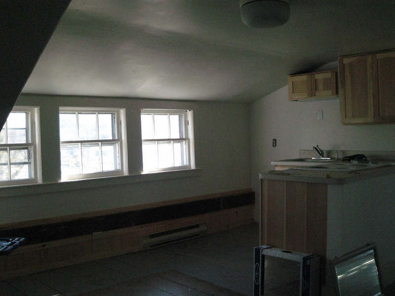 Kitchenette, dining area. Refrigerator will go in the corner to the left of the cupboards. the kitchen is only a couple of years old.