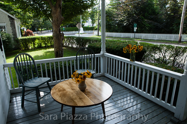 The porch overlooks Main Street and is a fine place to sit and watch the world go by.