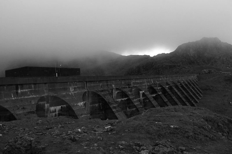 Ffestiniog HydroElectric Dam, taken on the 3rd of June 2005. The Ffestiniog dam is a Pumped Storage facility, this is the upper lack that holds the water, generally pumped there during the night. The weather at the height of this dam is often not so nice.