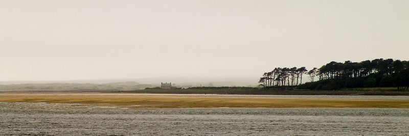 A solitary house during a dreary day, taken on the 1st of June, 2005. The beach can be seen in the mist from Canerfon, North Wales. An alternative crop is also availabile. Contact me if you wish to buy prints of this, as Smugmug don't offer Panoramic printing.