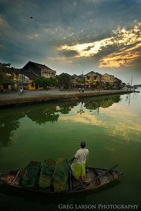 Fisherman tending to his nets, Hoi An, Vietnam.