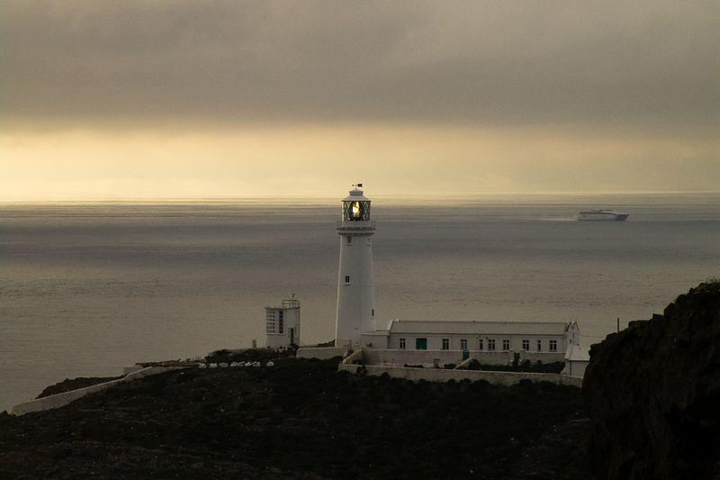 Sundown near a lighthouse on Angelsea, North Wales.