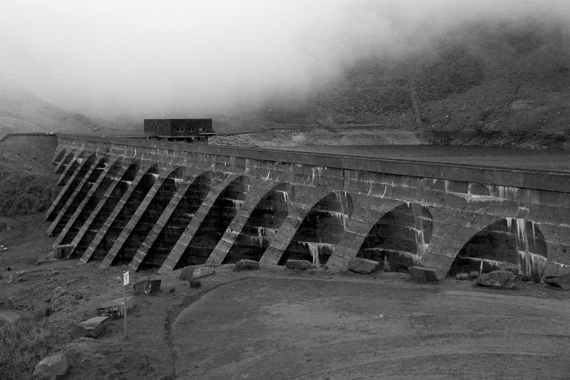 An alternative view of the Ffestiniog HydroElectric Dam, taken on the 3rd of June 2005. The Ffestiniog dam is a Pumped Storage facility, this is the upper lack that holds the water, generally pumped there during the night. The weather at the height of this dam is often not so nice.