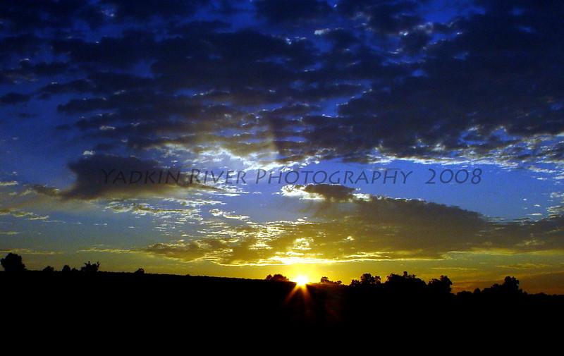 Early morning sunrise on Bobby June Hobson's farm. East Bend, NC