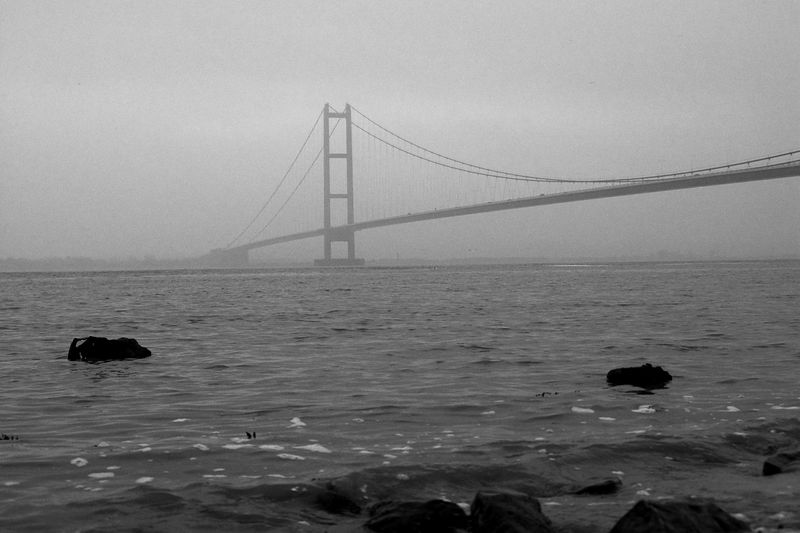 The Humber Bridge in the fog on a windy day. Taken on the 7th of November, 2004. Taken some 10 miles from Hull, in East Yorkshire, UK.