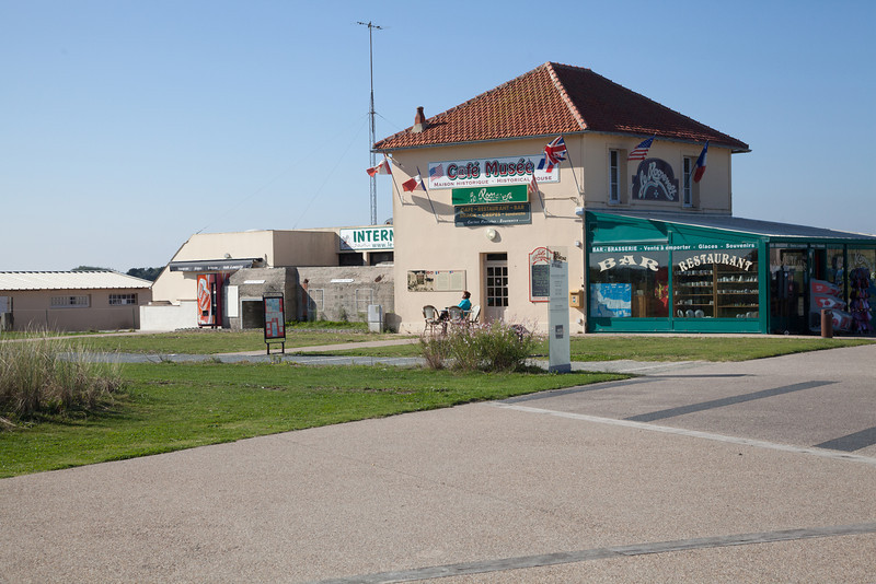 The low building behind this restaurant (only 100 yards from Utah Beach), now serves as the wine cellar. During the war, it was a German garrison.