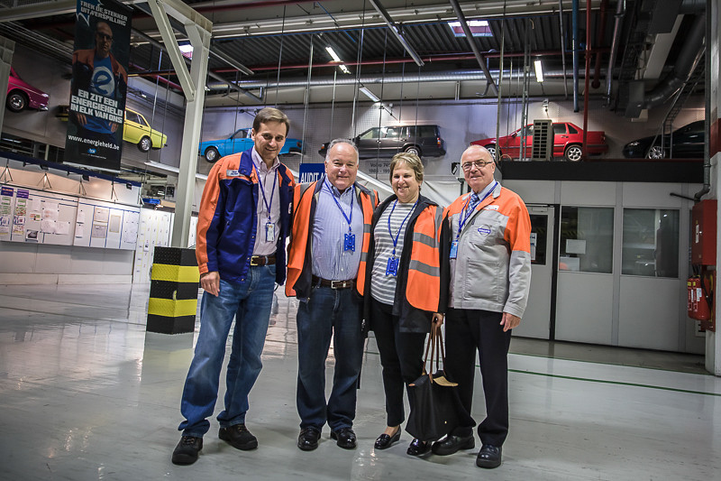 With Volvo plant officials in front of a display of prior models made in this plant.