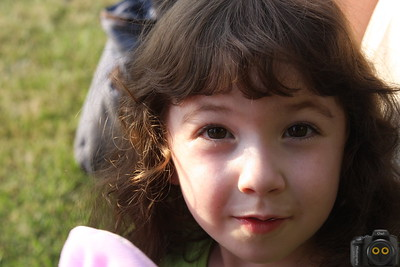 Portrait of a Little Girl with dark brown hair.