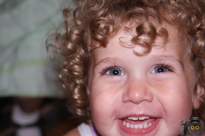Portrait of a Little Girl with curly brown hair.
