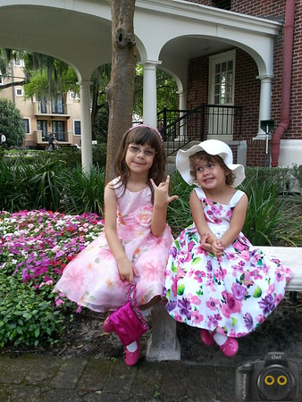 Portrait of two Sisters in flower dresses.