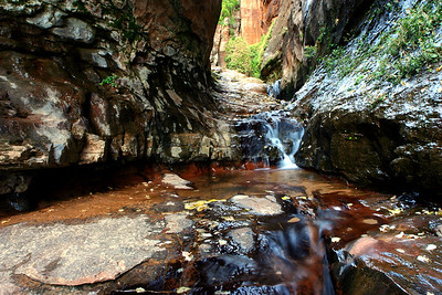 One of a few called Water Canyon. This is near Hildale and Colorado City in Southern Utah. The water seeping from the sandstone has not touched the air in thousands of years. So crystal clear and refreshing, take my word for it.The gentle sound of these waterfalls add serenity and music to your ears.