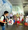 Roger Fernandes uses drum during storytelling at Olympic Sculpture Park for Seattle Art Museum's Salmon Return Festival.