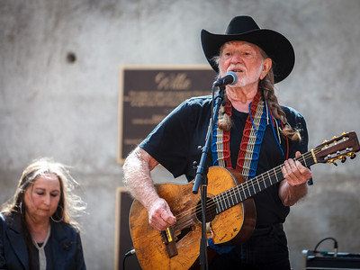 Willie Nelson playing during the unveiling of his bronze statue in Austin, TX on 4/20 at 4:20pm