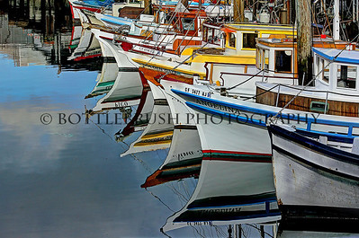 Fishing boat reflections.