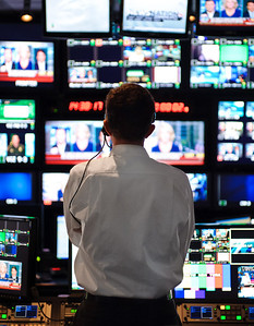 """NEW YORK, NY - OCTOBER 10:  A control room operator at Fox News studios in New York monitors a live broadcast of """"America Live"""" with host Megyn Kelly. Fox News Channel celebrated its 15th anniversary on the air on October 7th."""