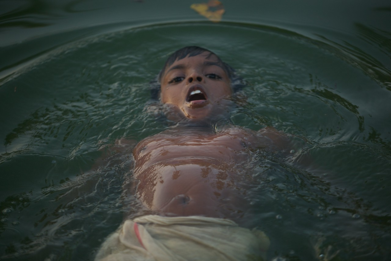 Little boy swimming in the backwaters