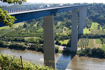 "Our first stop in Germany was at the ""Europabrug"" (crossing the river ""Moesel""). The Moselle Viaduct (German: Moseltalbrücke) carries the Bundesautobahn 61 over a meander of the river Moselle, connecting the Hunsrück and Eifel mountain ranges. It was built between 1969 and 1972 between the German villages Winningen and Dieblich, about 10 kilometres (6.2 mi) southwest of Koblenz, where the river Moselle flows into the river Rhine."