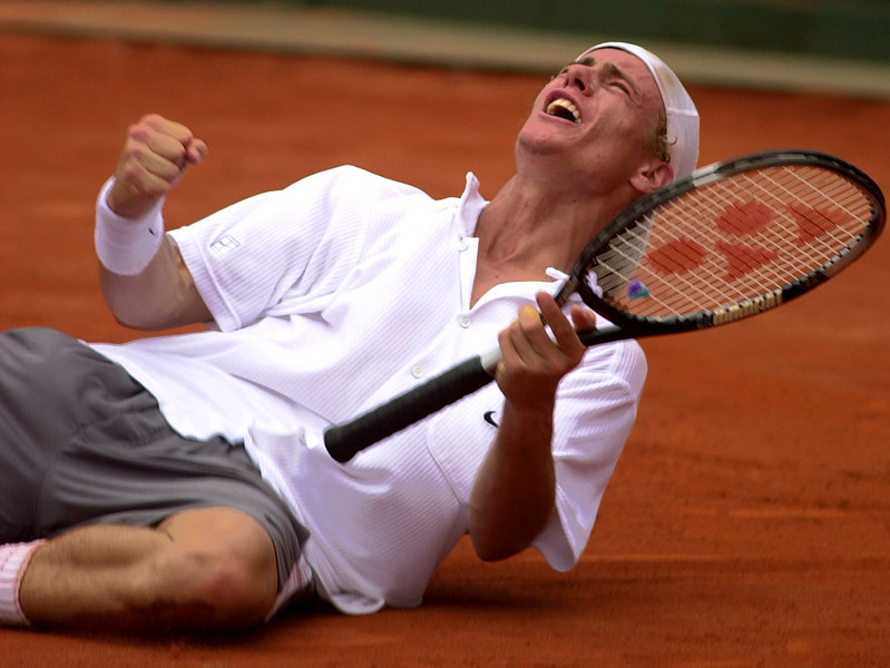 Lleyton Hewitt of Australia celebrates his Davis Cup victory against Gustavo Kuerten of Brazil in Florianopolis, in the southern Brazilian state of Santa Catarina, Sunday, April 8, 2001. Australia won the quarterfinal with his victory. (AP Photo/Douglas Engle)