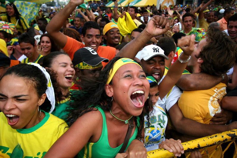 Fans of the Brazilian soccer team celebrate a goal as they watch the team play Australia during the World Cup on a large screen at a street party in Rio de Janeiro, June 18, 2006. Brazil won the match 2-0.