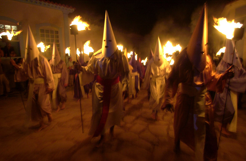 In a Holy Week ritual re-enacting the capture of Jesus by the Roman army, hooded men walk the streets of Goias Velho, a Portuguese-colonial town in the central Brazilian state of Goias, early March 28, 2002. The hooded men are a tradition of Seville, Spain, and brought to Goias Velho, former capital of the mining state, Minas Gerais, by Spanish Priest Joao Perestrello de Vasconcelos Spindola in 1745.(AP Photo/Douglas Engle)