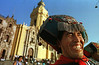 An Indian man from Huancavelica smiles during a cultural ceremony in the main plaza of Lima, Peru, Tuesday, April 15, 1997. Hundreds converged on the plaza performing dances and music.(AP Photo/Douglas Engle)
