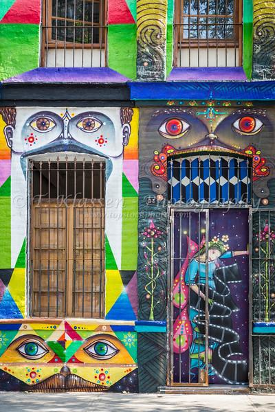 Street art,shops and graffiti along Pio Nono street in Santiago, Chile, South America.