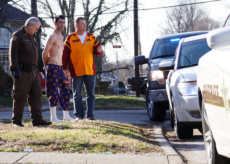 Mike Huebner is taken into custody by Gibson Coutny Sheriff's Office Captain Tim Bottoms; left and Princeton Police Detective Mike Hurt; right on suspicion of aggravated battery near a duplex at the corner of North Main and East Pine Street regarding a stabbing. The altercation took place at the duplex property and afterward; the victim; who's name was not released ran to the Cutting Edge Salon Across the street for help. He was taken by ambulance for medical treatment.; Mike Huebner is taken into custody by Gibson Coutny Sheriff's Of; right on suspicion of aggravated battery Thursday Feb. 2 afterno; who's name was not released ran to the Cutting Edge Salon Across