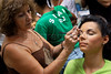 An inmate prepares to parade during a beauty pageant at the Talavera Bruce prison, Rio de Janeiro, Brazil, November 24, 2009. A jury elects the most beautiful among 15 contestants of three prisons in a beauty pageant held at the Talavera Bruce prison. The Miss Talavera Bruce Beauty Pageant is an important break from the routine life of about 330 female inmates in the maximum security prison. The Rio de Janeiro prison is a notorious Bangu area, where some of Rio's top drug traffickers are held. The fifth annual pageant, which the VivaRio non-governmental organization helps organize, tries to transform these dangerous criminals into beautiful, dazzling, beauty pageant hopefuls for one day. (Austral Foto/Renzo Gostoli)